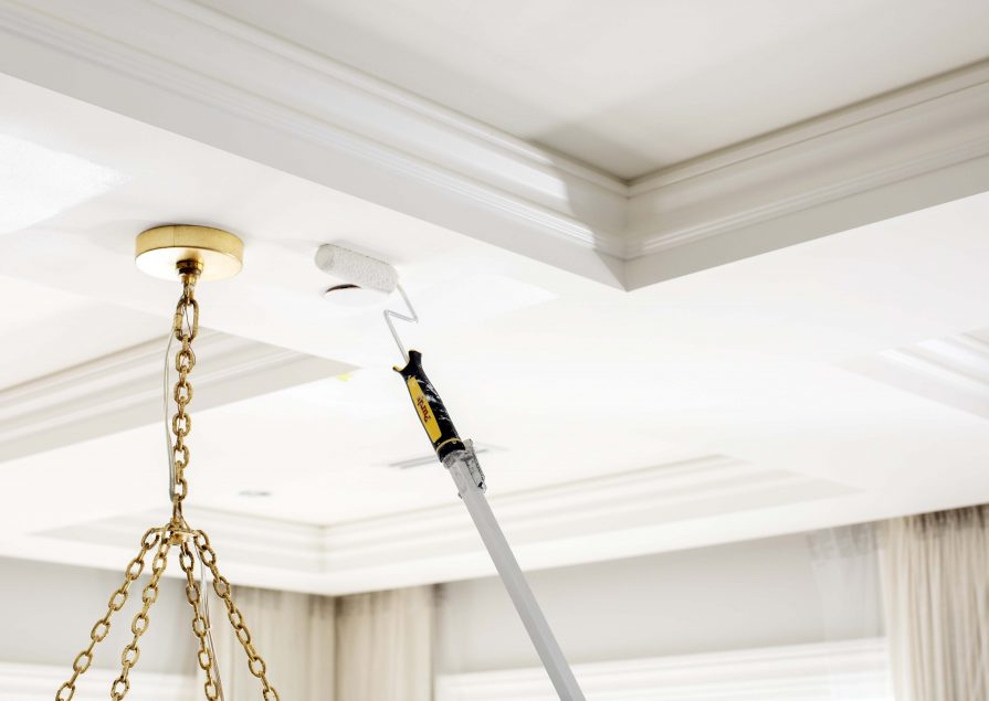 A Hemlock Painting employee paints a ceiling with efficiency and expertise; we are provide the best in House Painting services throughout the Greater Vancouver area.