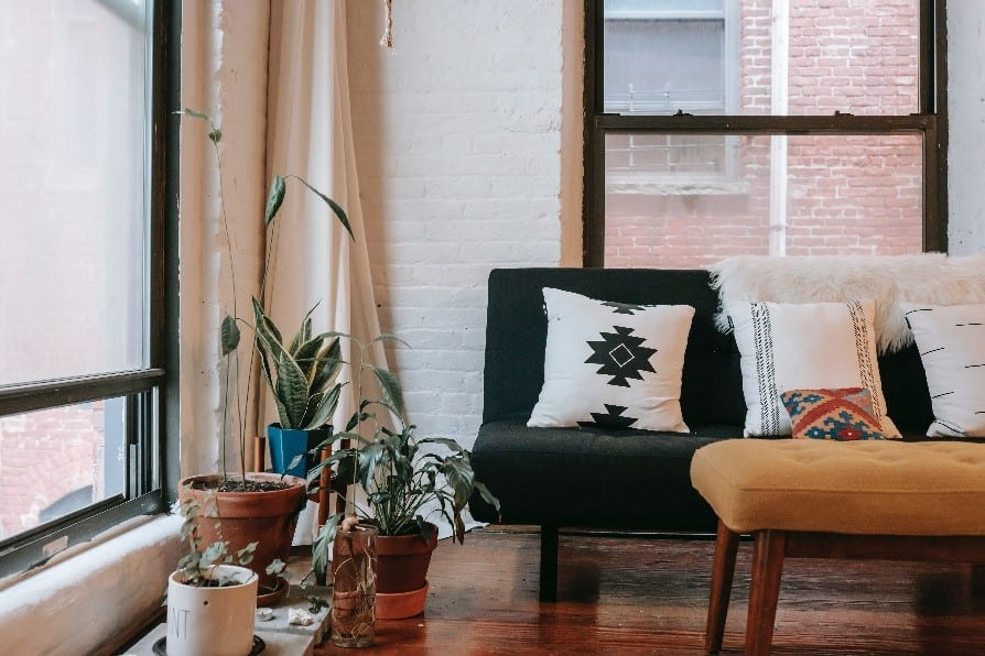 A living room is made all the more comfortable with a trendy white brick wall.